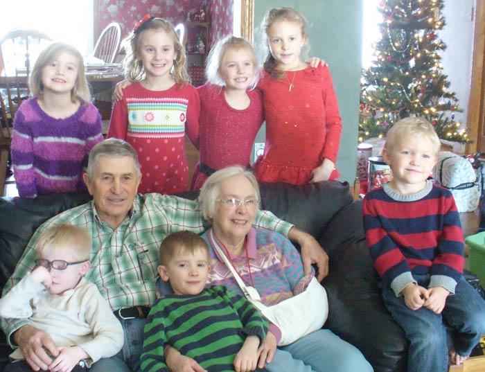 Eric and his wife, Janis Berger,enjoying their grandchildren