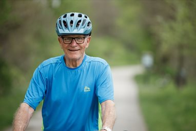 Three months after spine surgery, Jim Marks returned to an activity he missed the most, riding his bike.